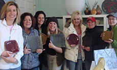Girls Night Out participants with their clay plates.